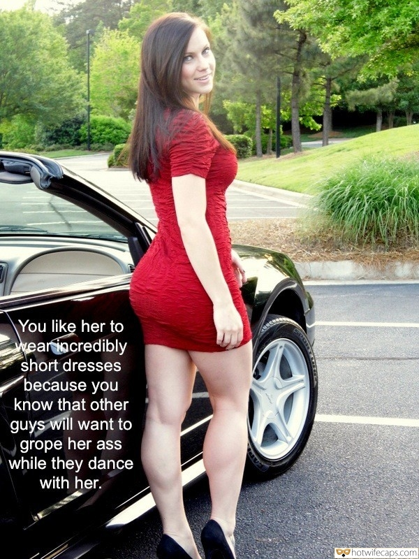 SFW Caps  hotwife caption: You like her to wear incredibly short dresses because you know that other guys will want to grope her ass while they dance with her. Brunette in Tight Red Dress Poses by Expensive Car